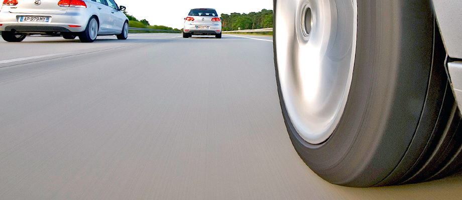 View of a tire flush with the ground on a highway