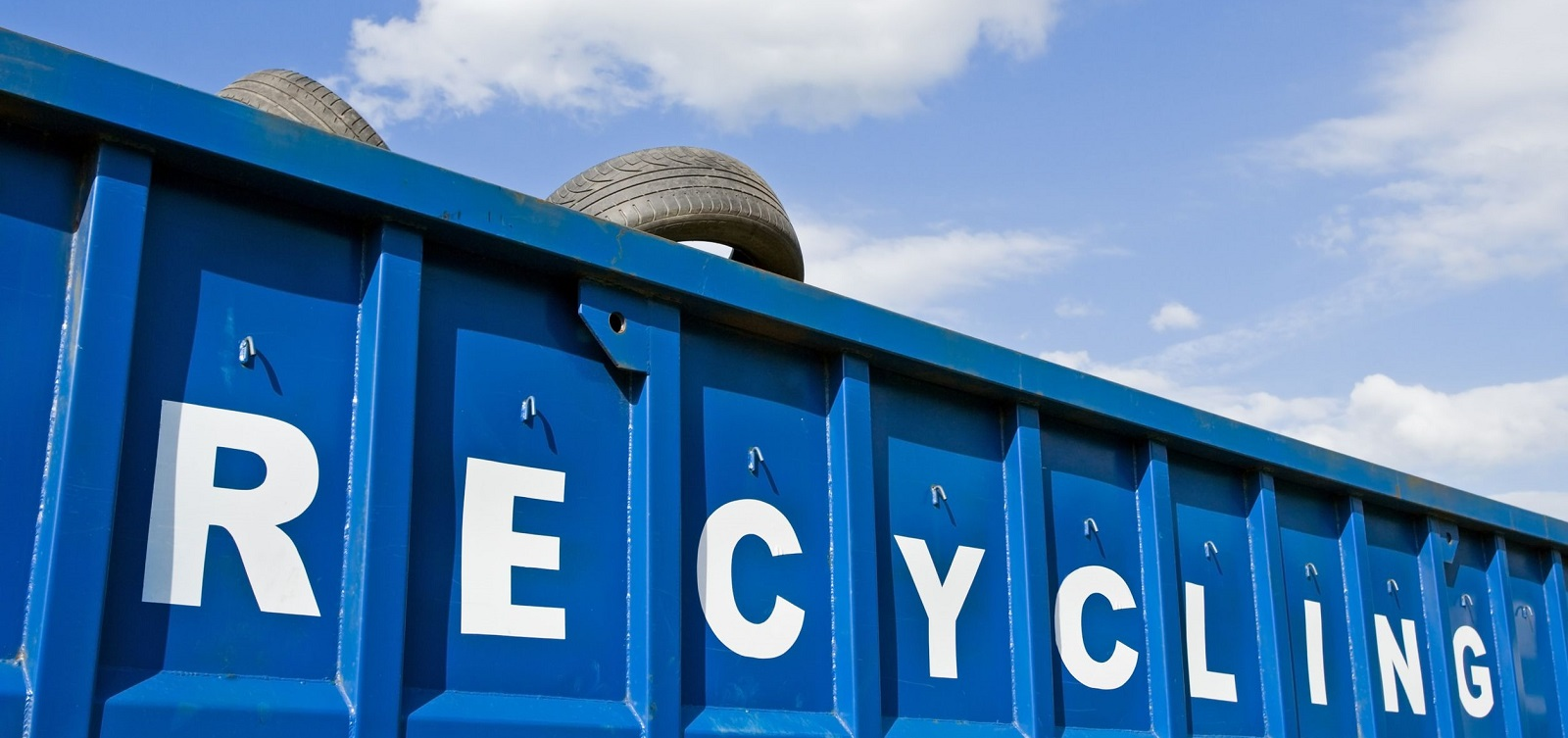 7712174 - tire recycling container over blue sky